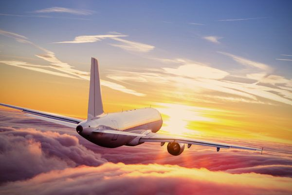 airplane-flying-above-clouds_shutterstock_553131187-1068x601
